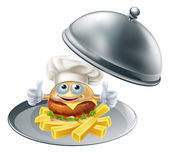 An illustration of burger chef mascot character and chips on a silver serving platter