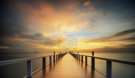 Photo for Wooded bridge in the port along sunrise. - Royalty Free Image