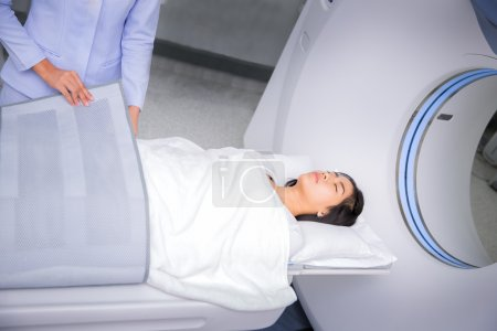 Asian lady sleep on a CT Scan bed