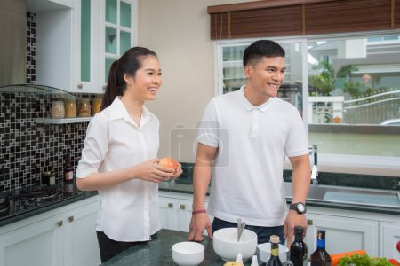 Family just married in kitchen room