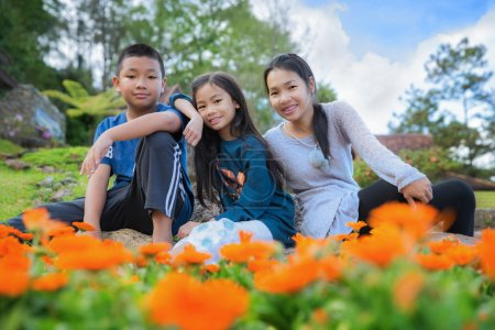 Photo for Family, mon, daughter and son too smile in gardent - Royalty Free Image