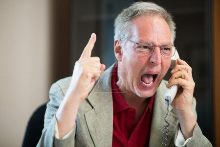 Photo for Portrait of an angry businessman yelling at phone - Royalty Free Image