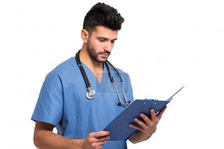 Doctor reading a document