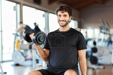 Photo for Handsome man training in a gym - Royalty Free Image