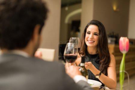 Couple toasting wineglasses in restaurant