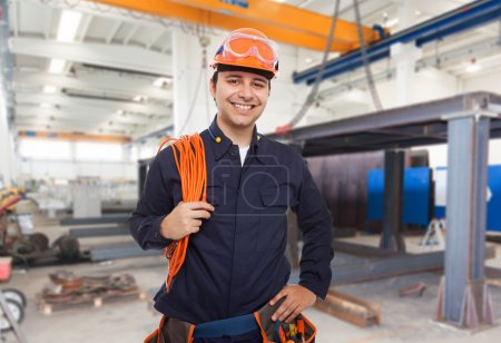 smiling engineer in factory