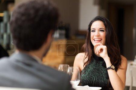 Cheerful couple in restaurant