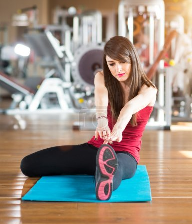 Woman working outs in gym