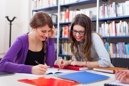 Photo for Group of students studying in the library - Royalty Free Image