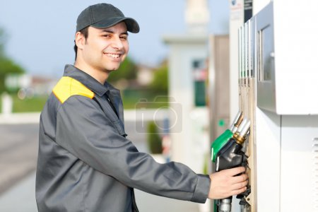 Smiling worker at gas station
