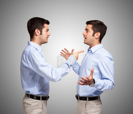 Photo for Man talking to a clone of himself - Royalty Free Image