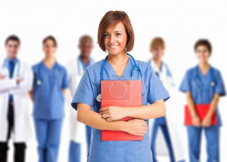 Nurse in front of medical workers