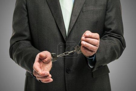 Handcuffed businessman