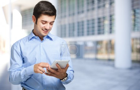 Businessman using tablet outdoor