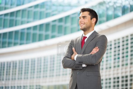 Young businessman with folded arms