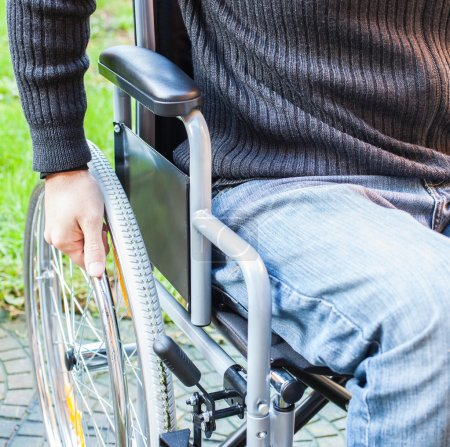 Photo for Paralyzed man using his wheelchair - Royalty Free Image