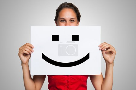 Woman with smiley emoticon