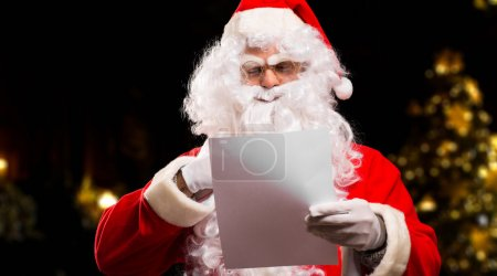 Photo for Santa Claus reading a letter - Royalty Free Image