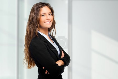 Photo for Smiling businesswoman in an urban setting - Royalty Free Image