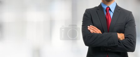 Photo for Impersonal portrait of businessman in suit with crossed arms with copyspace - Royalty Free Image