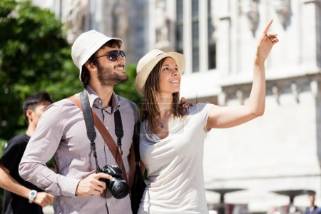 Photo for Tourists walking and having fun in a city - Royalty Free Image