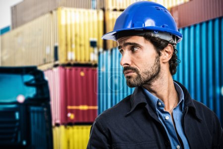 Worker in front of containers