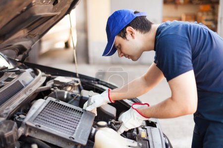 Mechanic using a wrench