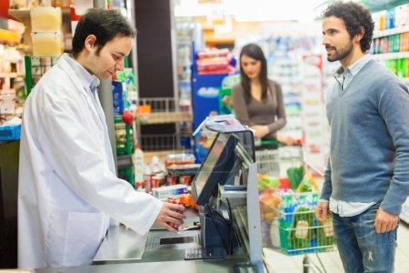 Storekeeper serving customers