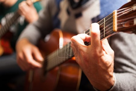 Classical guitar player