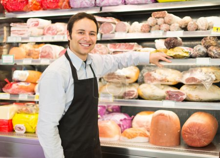 Smiling shopkeeper in grocery store