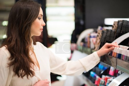 Woman shopping in a beauty shop