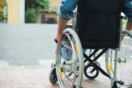 Photo for Detail of a disabled man trying to getting on a ramp - Royalty Free Image