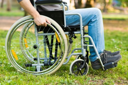 Photo for Detail of a man using a wheelchair in a park - Royalty Free Image