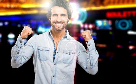 Handsome man winning at casino