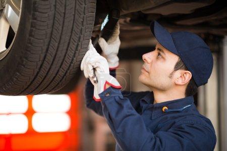 Mechanic inspecting a car