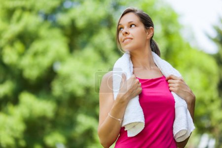 Woman refreshing after running
