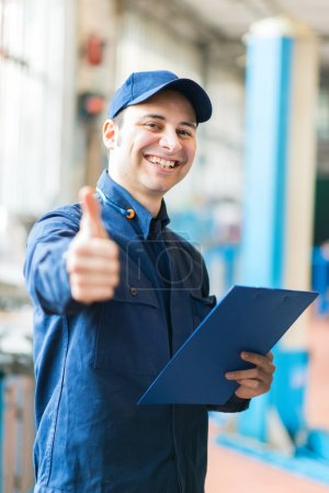 mechanic showing thumbs up