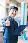 mechanic showing thumbs up