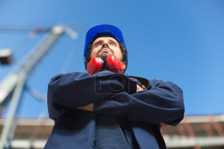 worker in front of construction site