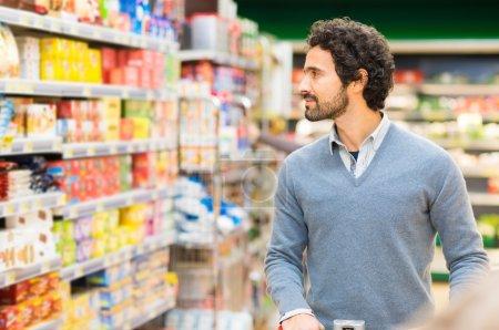 Man choosing product in supermarket