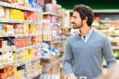 Man choosing product in supermarket