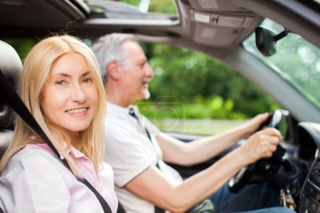 Mature couple traveling in car