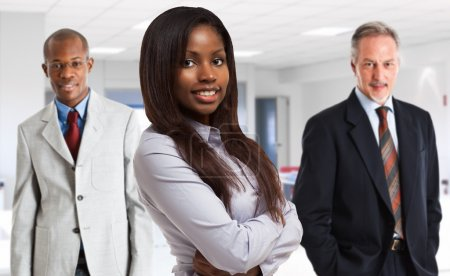 Photo pour Portrait of a businesswon in front of her team in offeice - image libre de droit