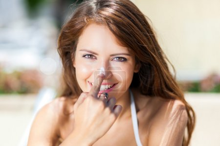 Woman applying sun screen on nose