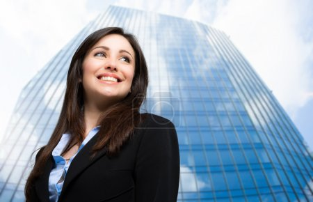 business woman in front of skyscraper