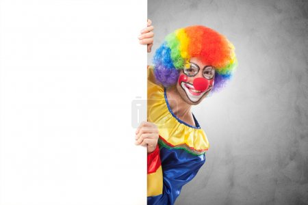 clown holding a blank panel