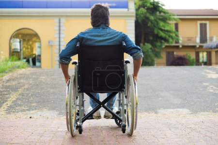 disabled man trying to getting on ramp