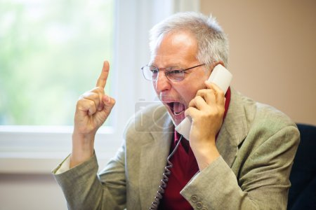 Photo for Angry businessman shouting on the phone - Royalty Free Image