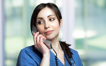Female nurse talking on the phone