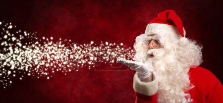 Photo for Portrait of Santa Claus blowing snow - Royalty Free Image